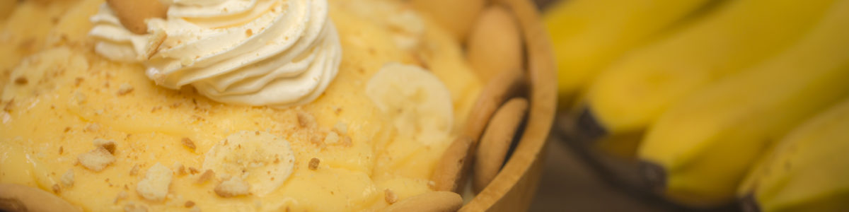 photograph of banana pudding with whipped cream topping and vanilla wafer crust